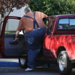 Sleep Apnea Trucking Obese man enetering his pickup
