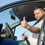 Sleep apnea truck driver wearing seatbelt giving the thumbs-up sign
